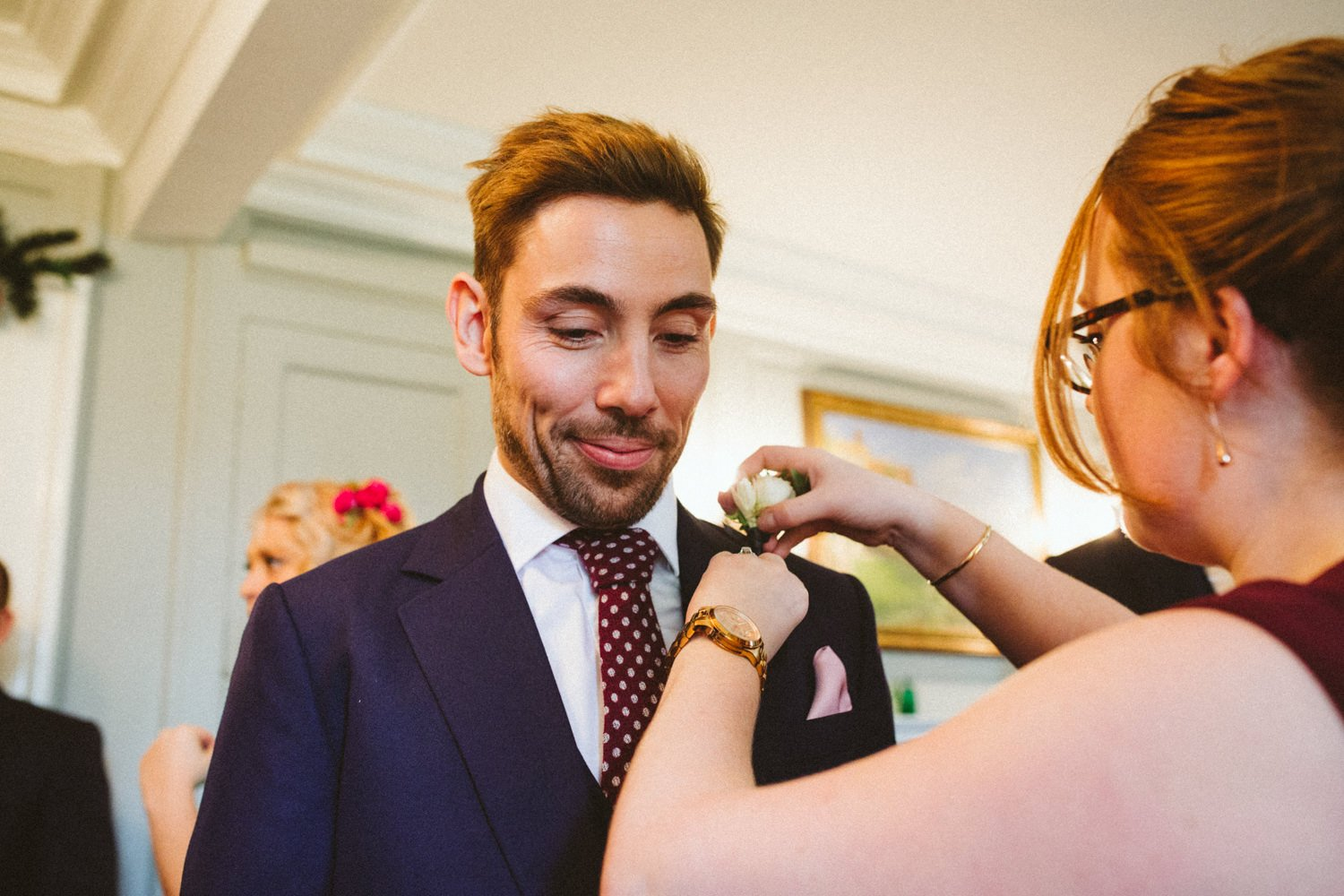 Yardsmen groom with buttonhole at Burgh House London
