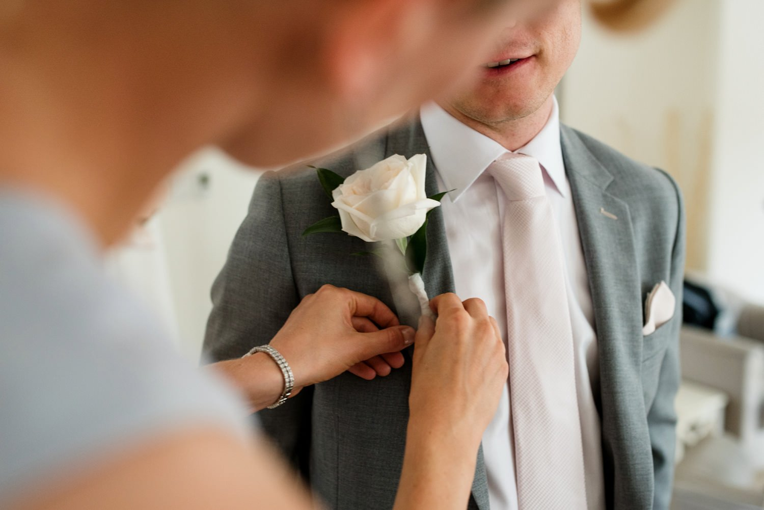 Fjura buttonhole for Paul Smith groom Devon wedding photography