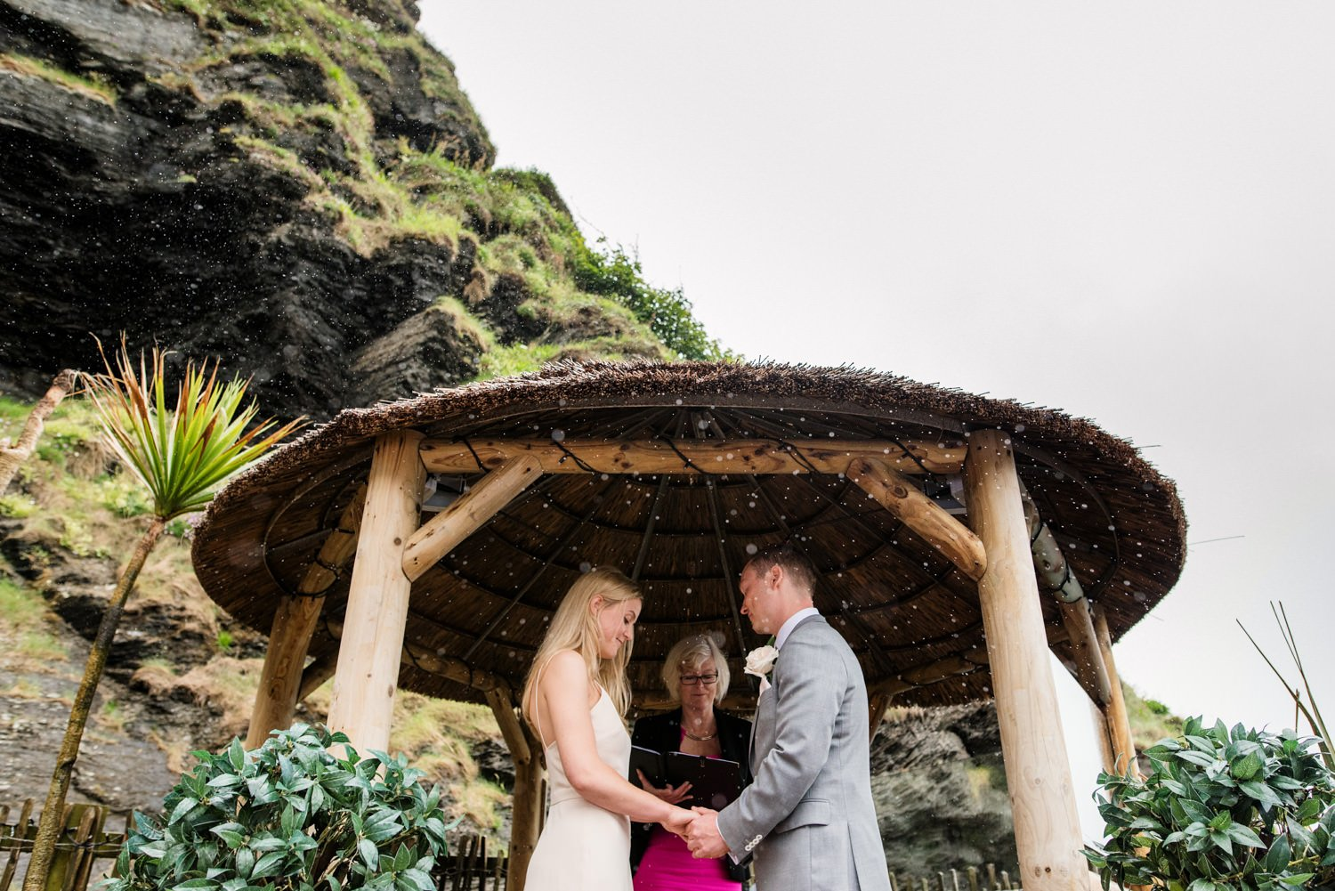 Rainy beach wedding ceremony Devon Babb Photo