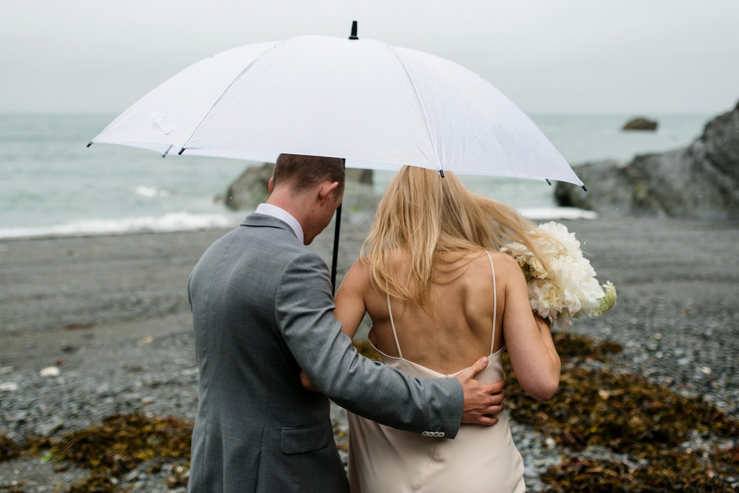 Tunnels Beach wedding portrait Devon Babb Photo