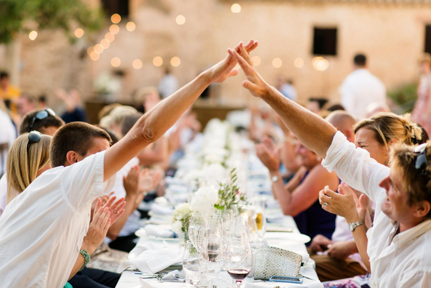 Fun high five for wedding guests Mallorca wedding photography Babb Photo