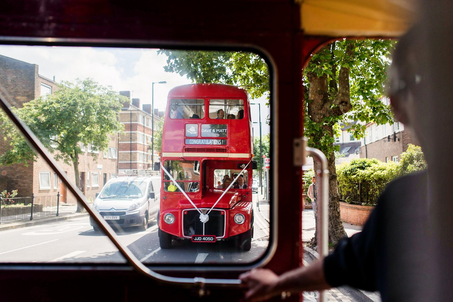 Red London bus for same sex wedding Hackney London