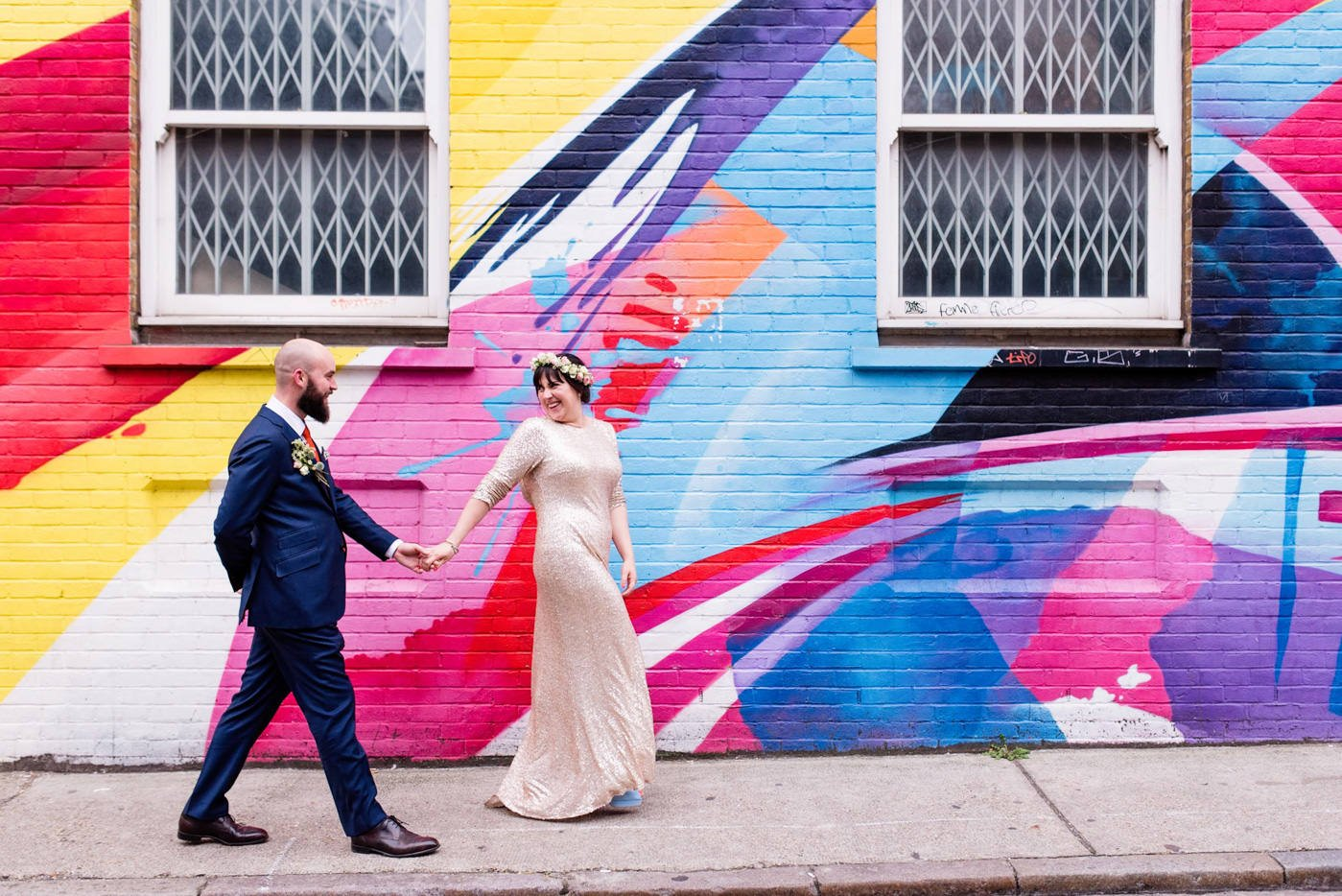 Wedding couple in front of colourful wall shoreditch
