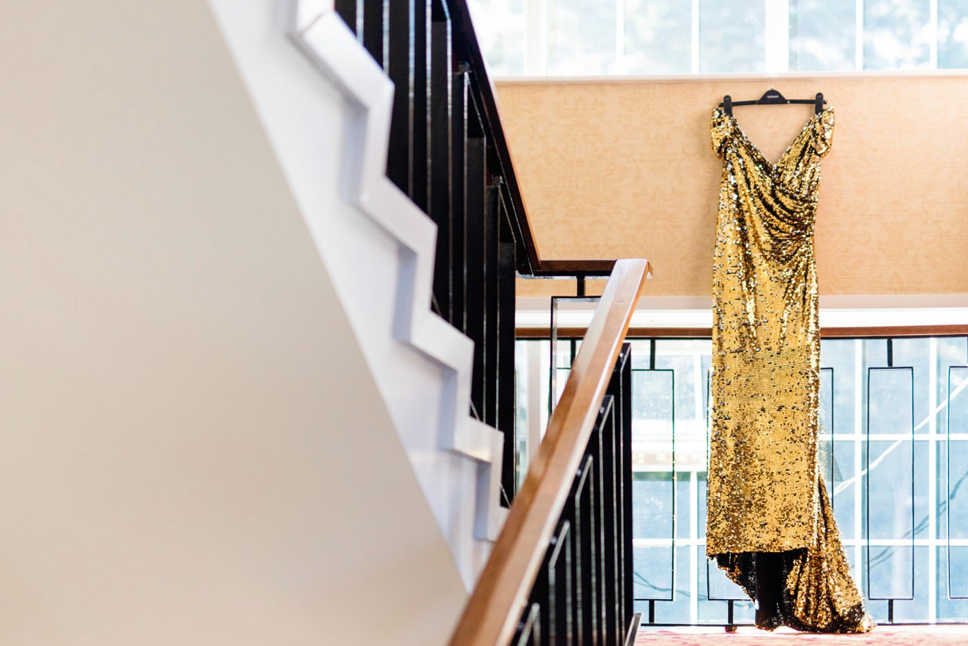 Hanging gold bridal dress from Maureen Patricia Toronto Surrey wedding photographer