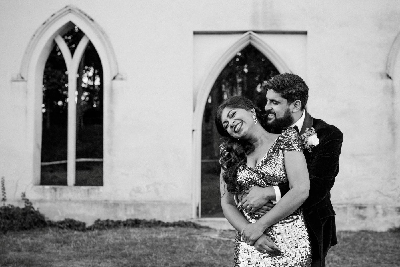 Bride wearing gold dress with groom at Painshill Park Surrey wedding