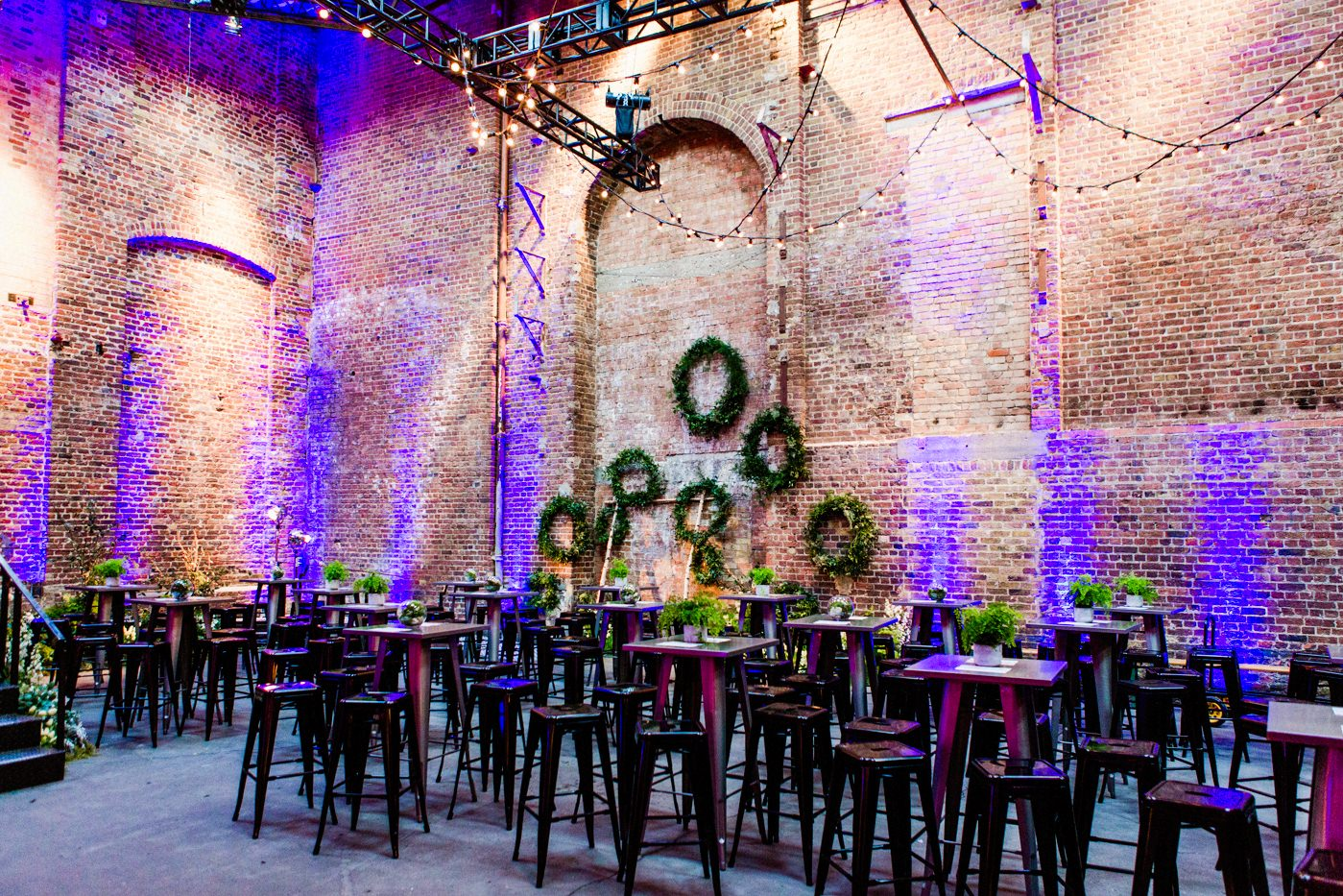 Incredible warehouse space at Village Underground in London set up for dinner with bunting and exposed brick walls