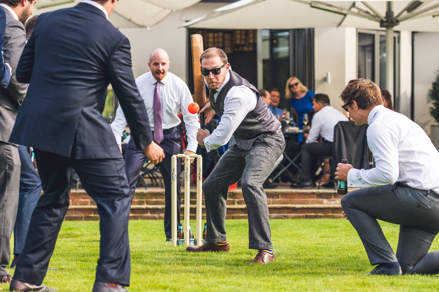 Groom playing cricket at wedding