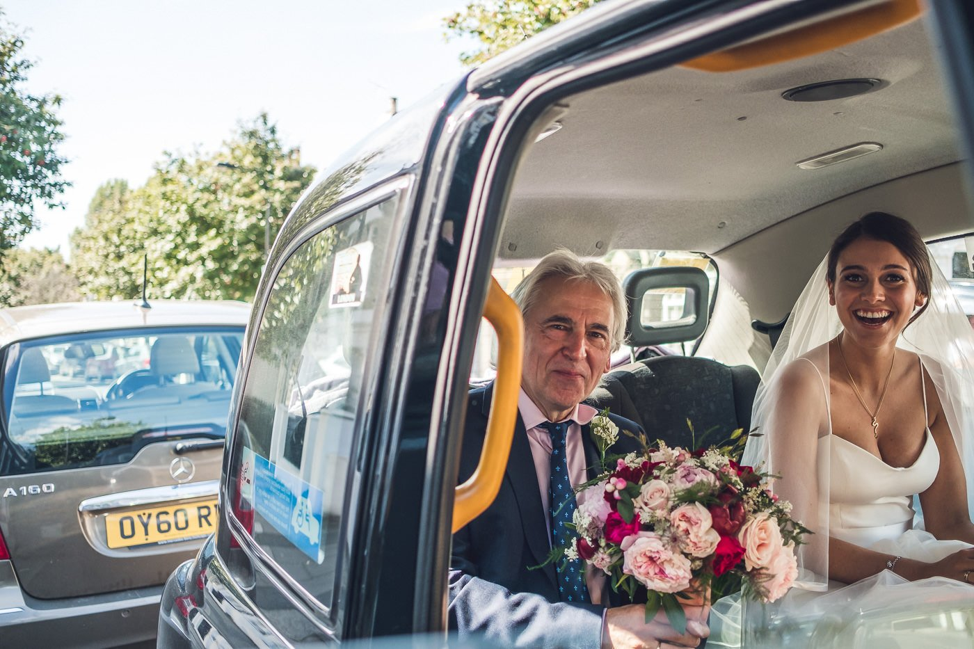 bride and dad in taxi timings on wedding day