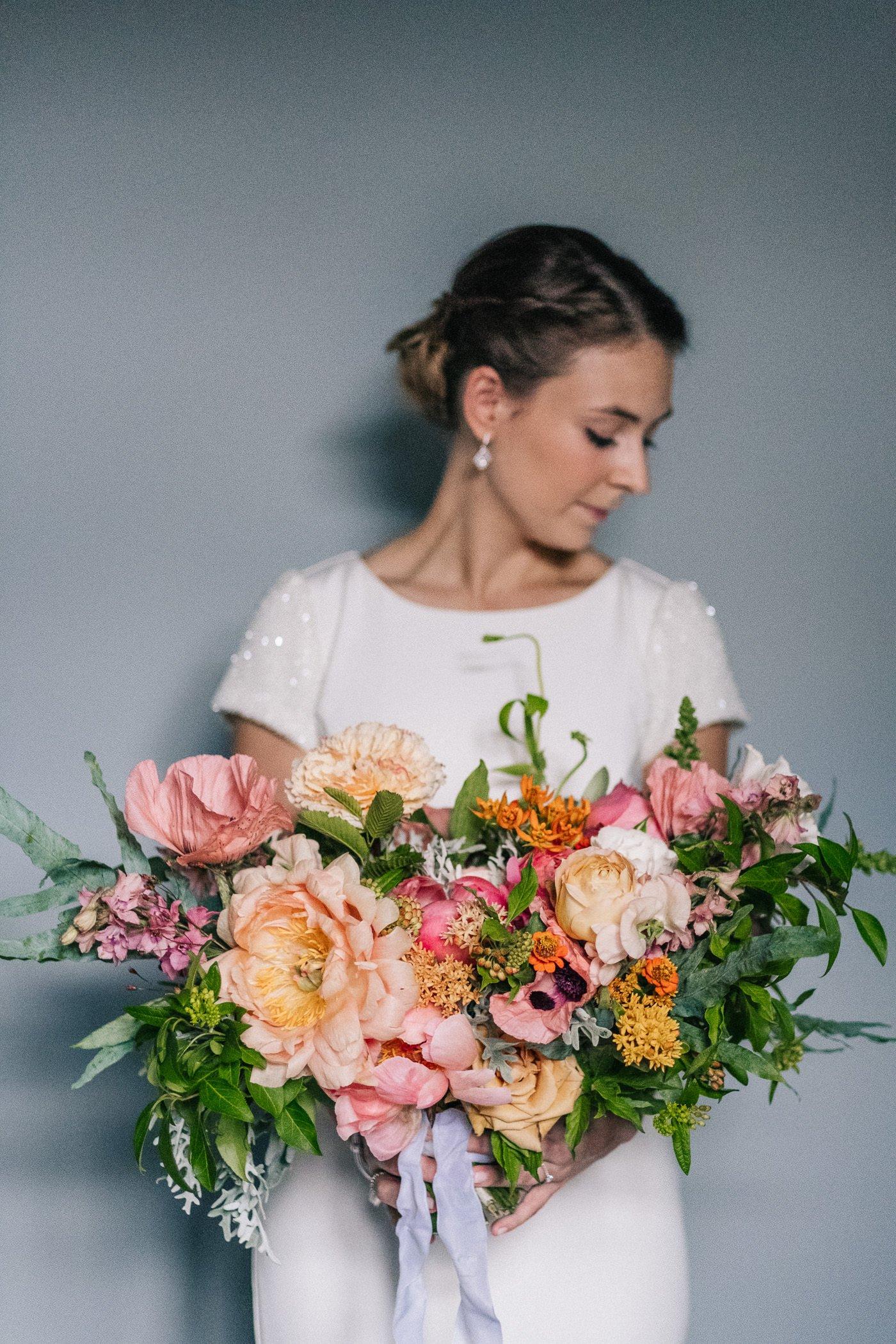 Alternative wedding photographer oversized bouquet
