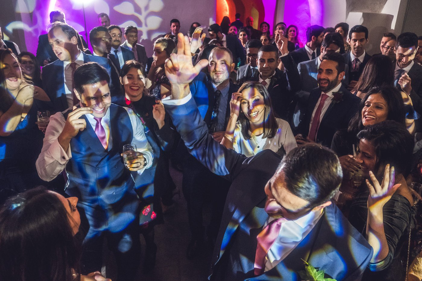 Wedding guests on dance floor at The Queens House Greenwich