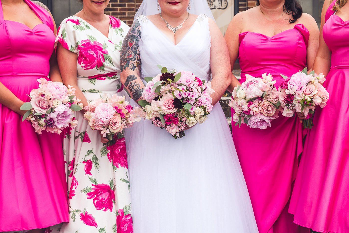 Alternative bridesmaids rock venue wedding