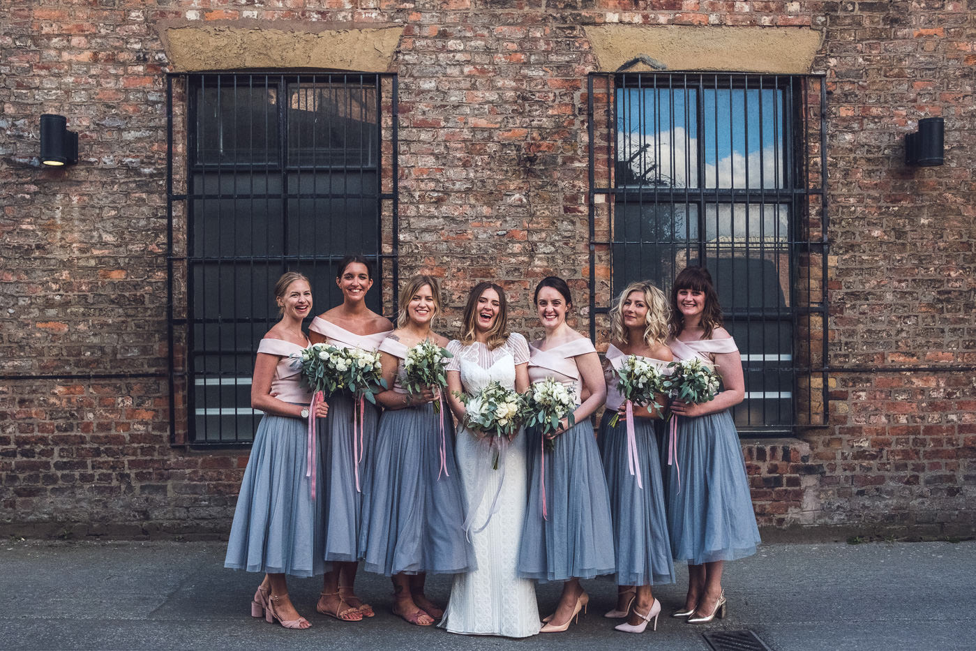 wedding planning advice bridesmaids in grey