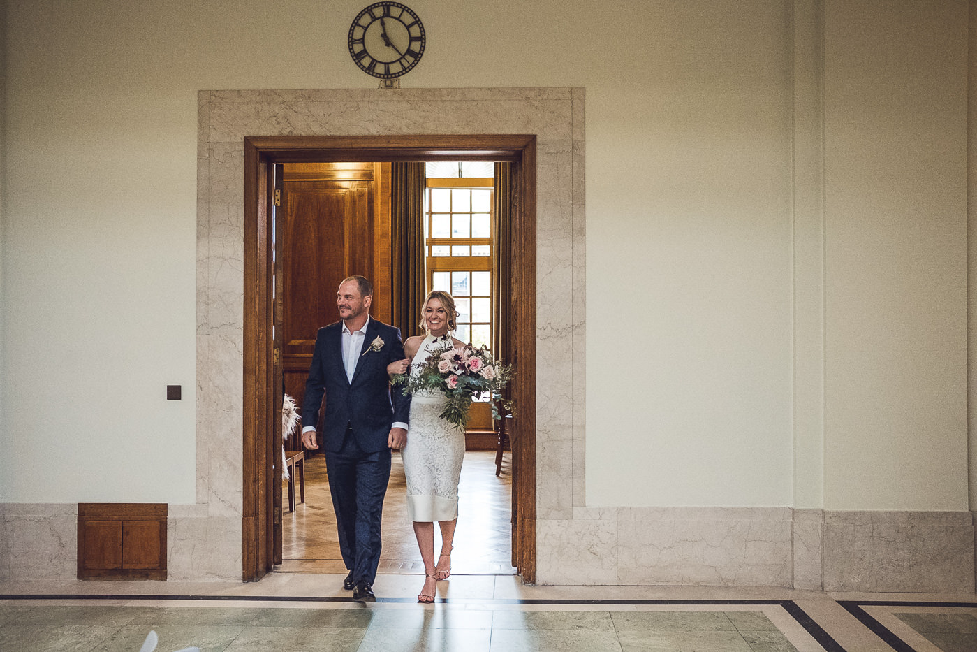 Exiting Council chamber Hackney Town Hall Elopement Photography London