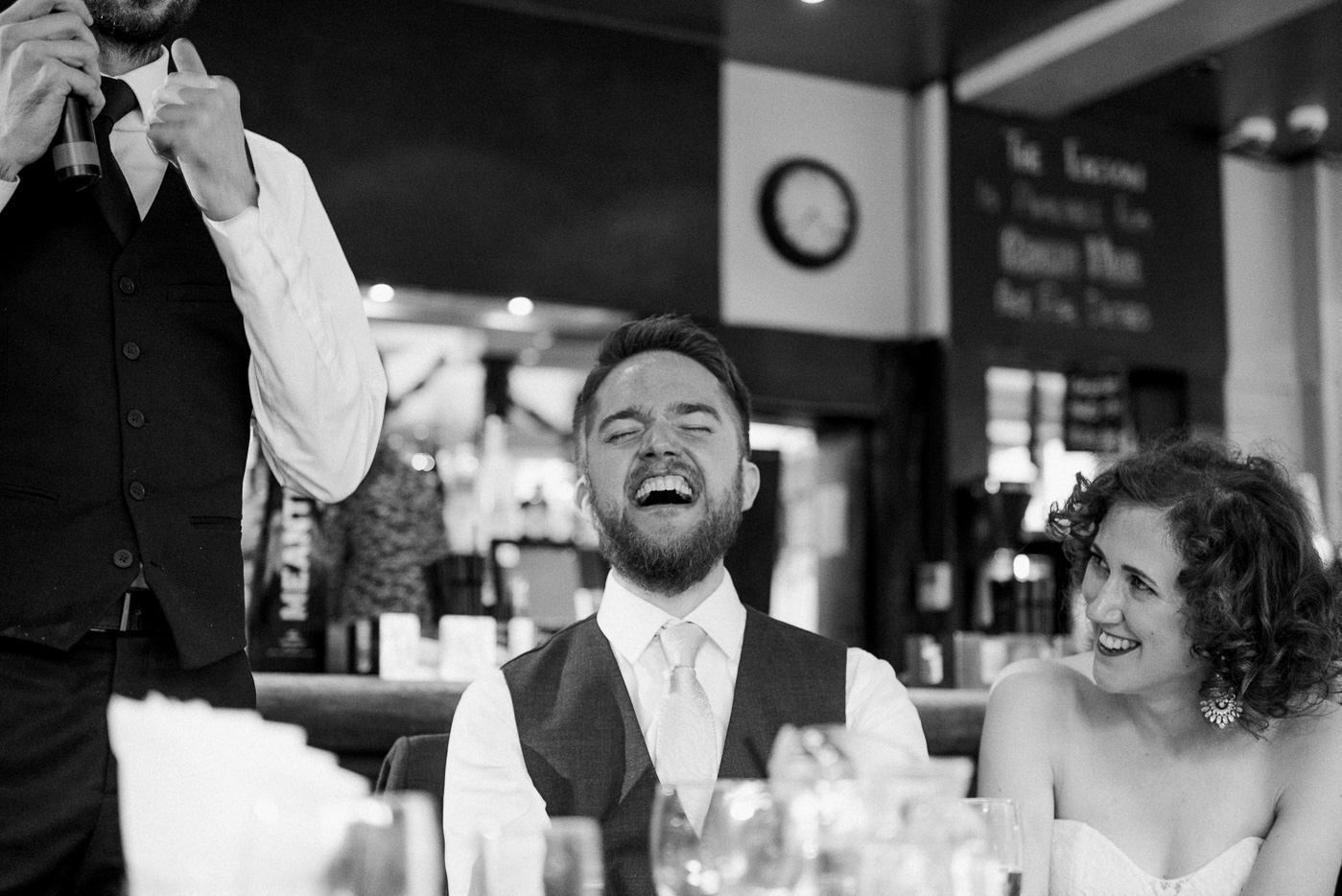 Groom laughing The Easton Pub wedding London wedding photographer