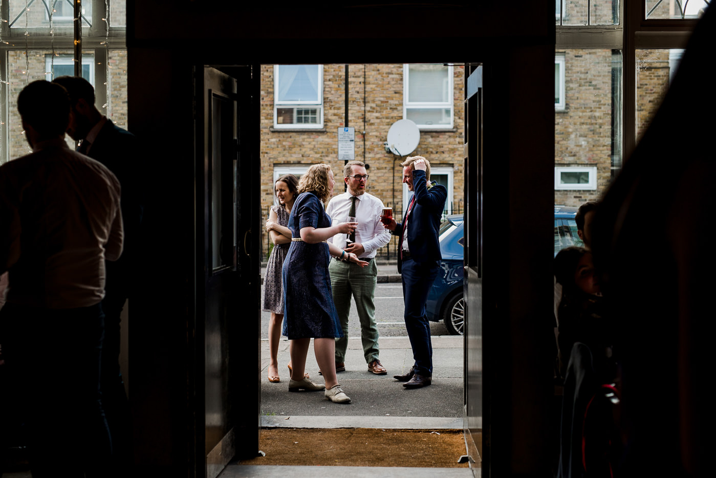 Guests drinking beer Drinks reception The Easton Pub wedding London wedding photographer