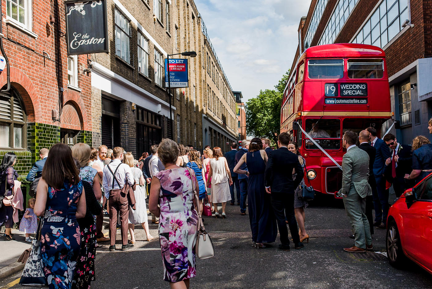 Red London bus wedding