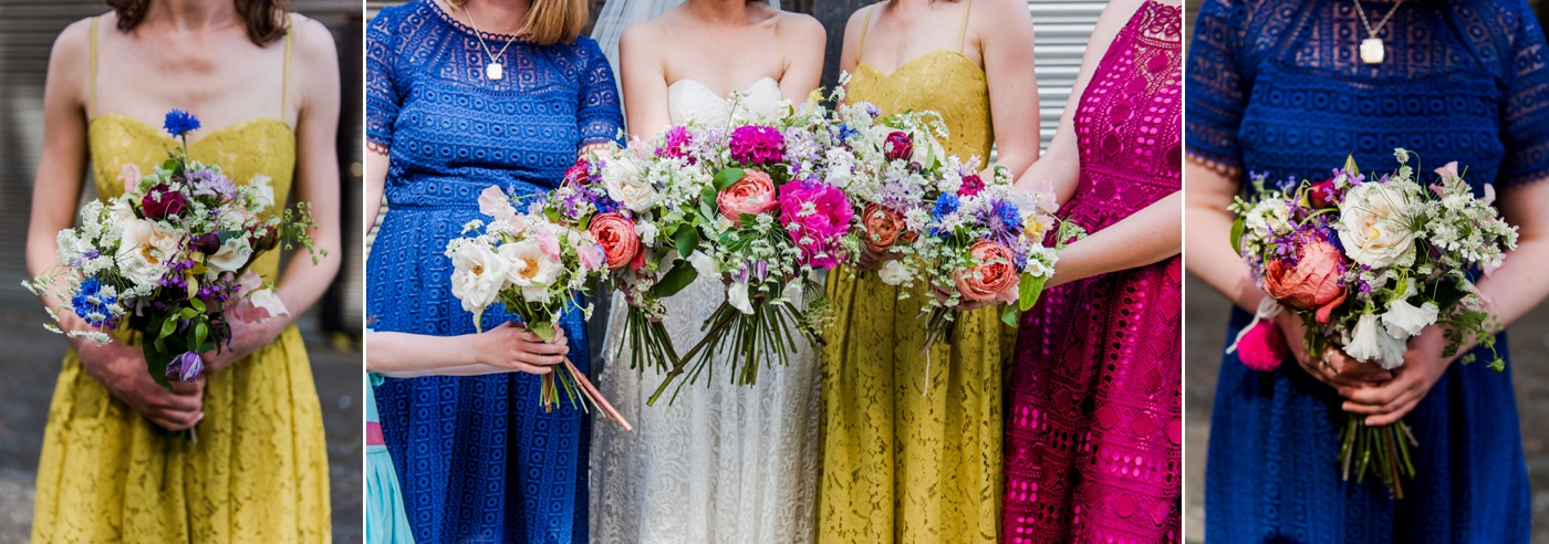 rainbow bridesmaids with quirky flowers