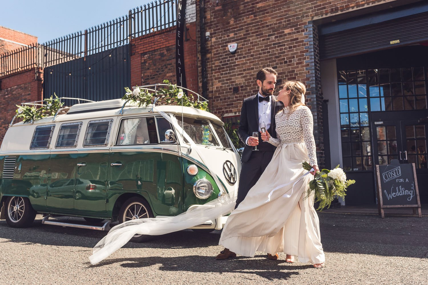 Bride and groom next to green WV camper van Constellations Liverpool