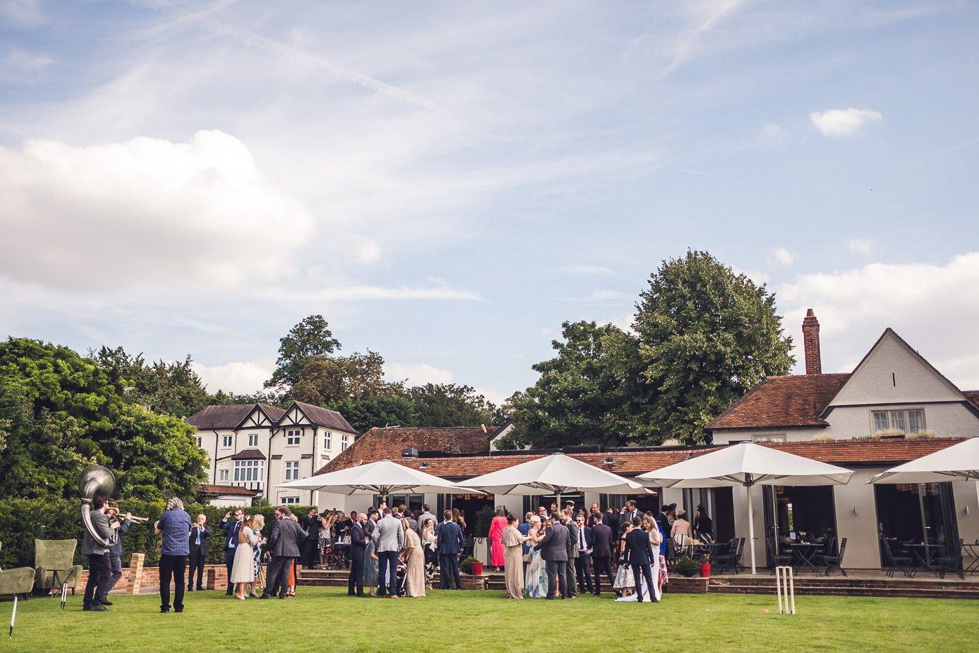 Great House at Sonning wedding guests enjoying sunshine