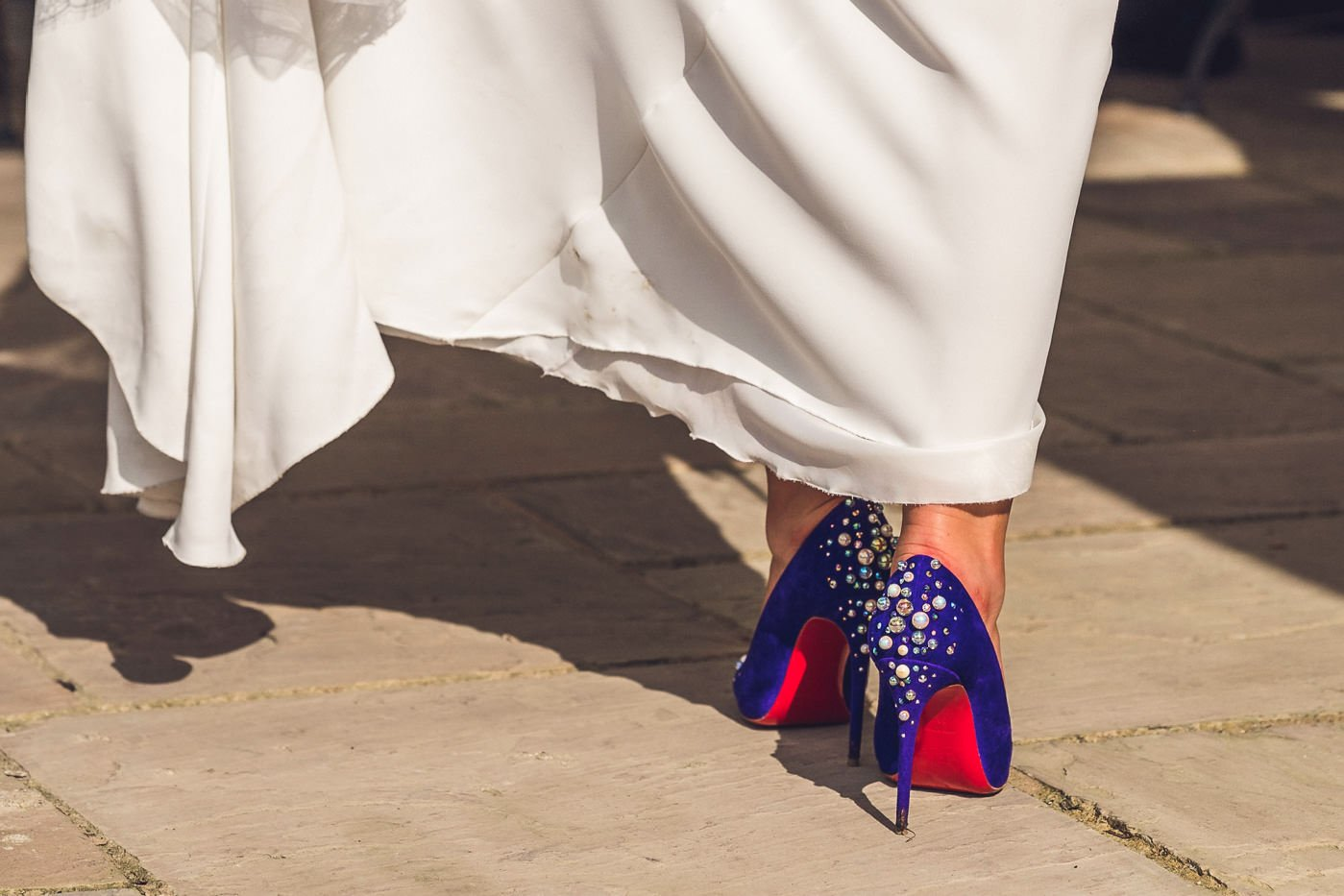 A bride in laboutin shoes