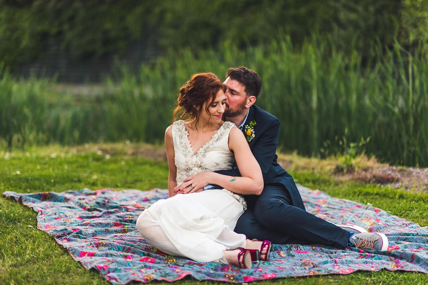 Couple sitting on blanket mile end art pavilion wedding