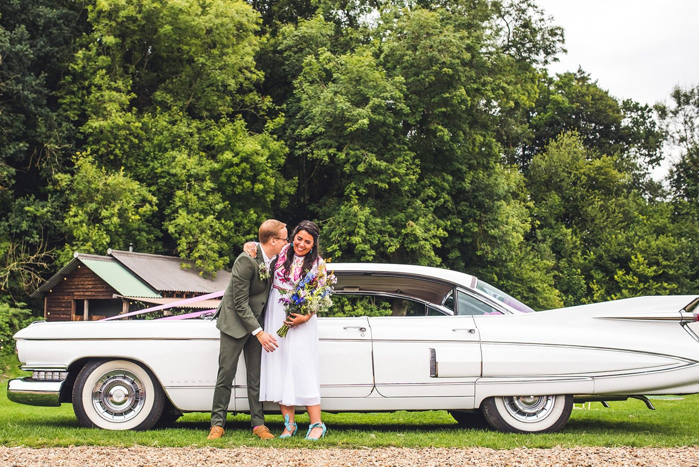 Bride and groom with vintage car advice for newly engaged couples