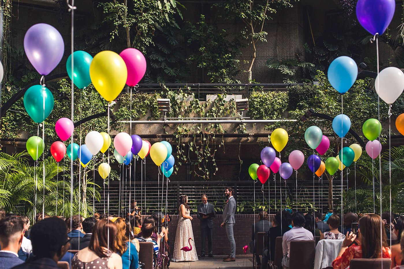 Colourful balloon backdrop at Barbican Conservatory wedding
