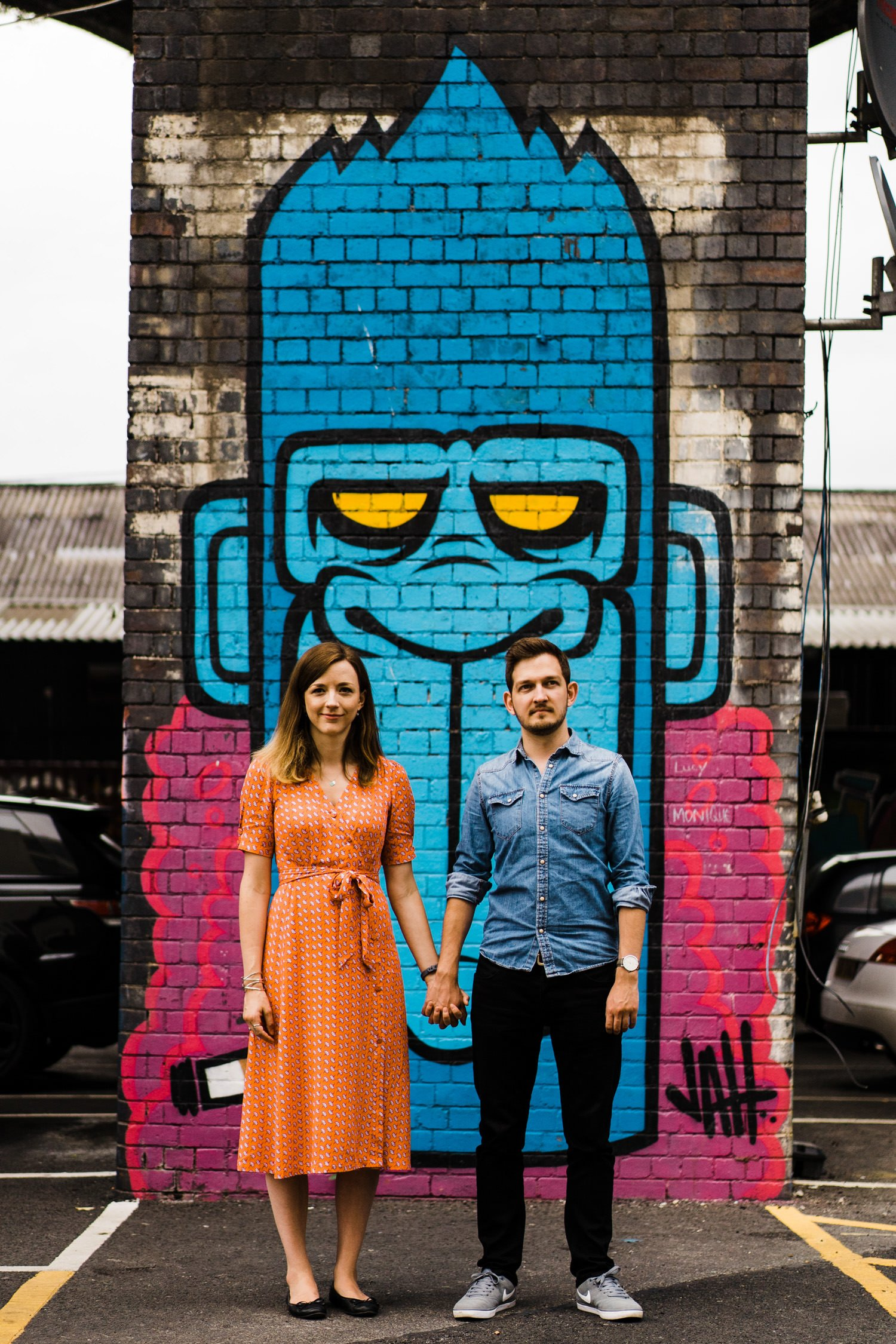Couple in front of monkey Digbeth Engagement Photography