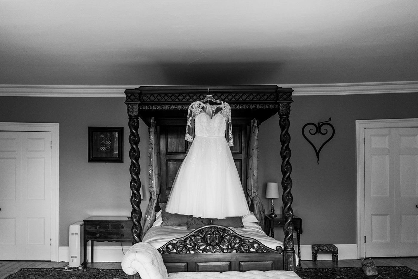 wedding dress hanging in black and white