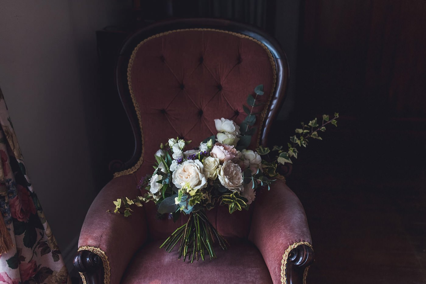 Flowers in velvet chair at homme house herefordshire