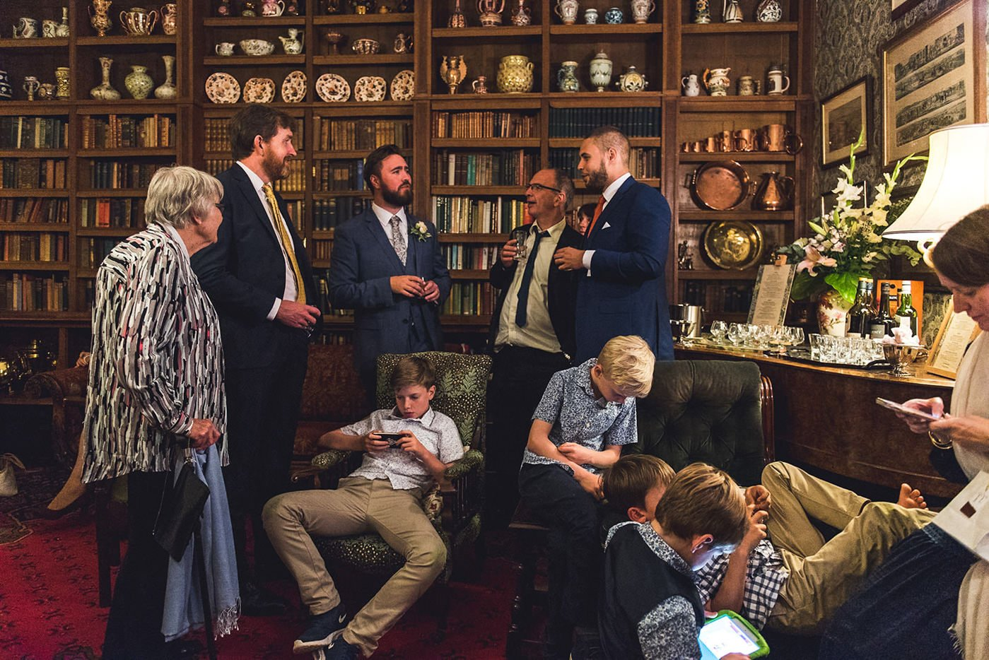 Homme House Wedding Photography a group gather in the library