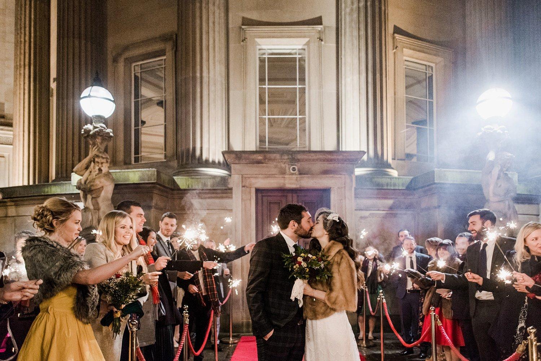 Bride and groom sparkler shot Christmas wedding