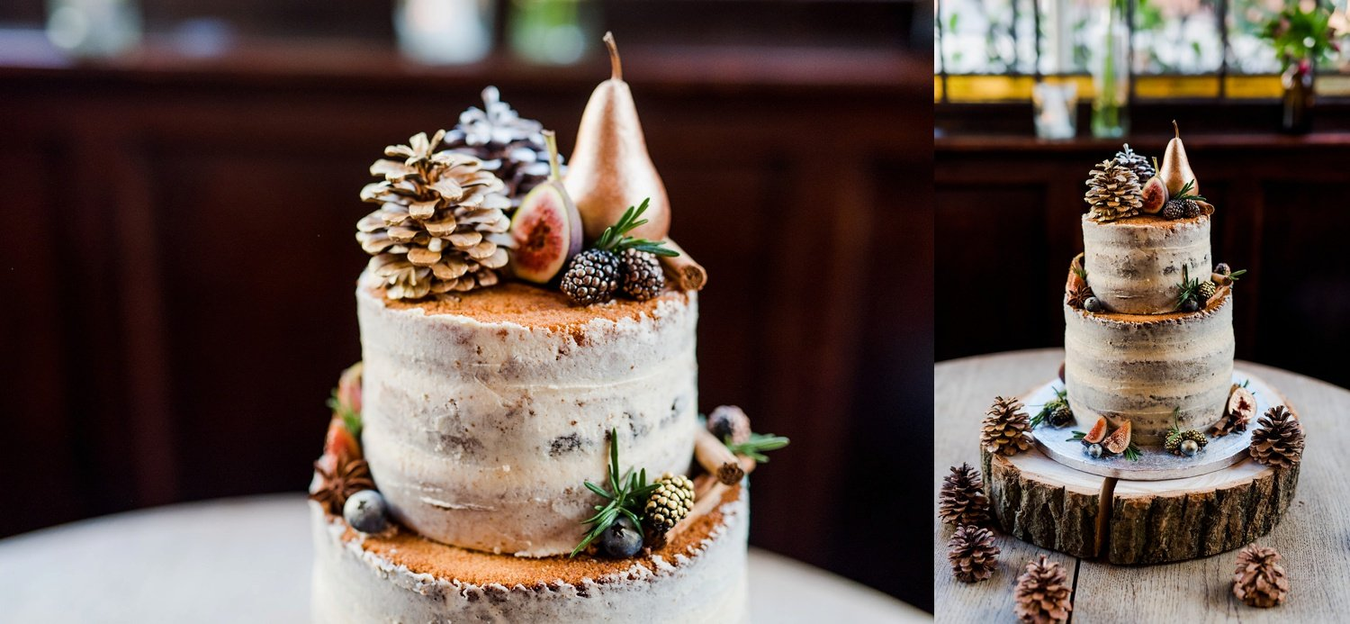 Naked cake with pinecones and gold fruit