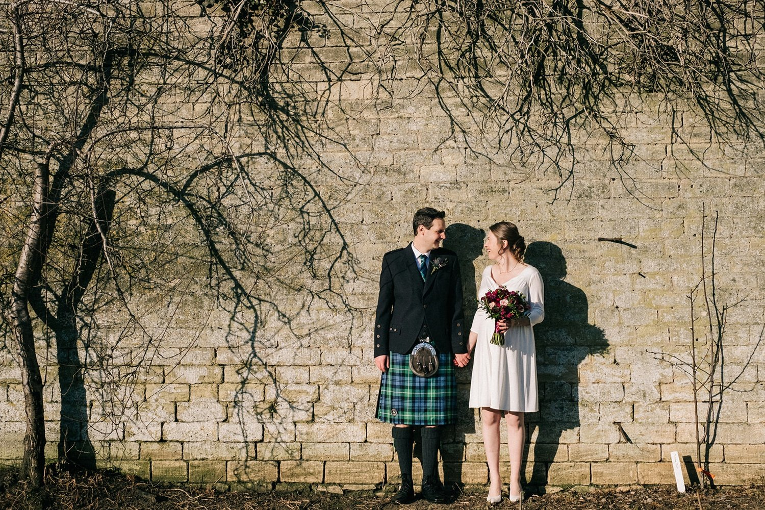 Bride and groom portrait brick wall woolley grange