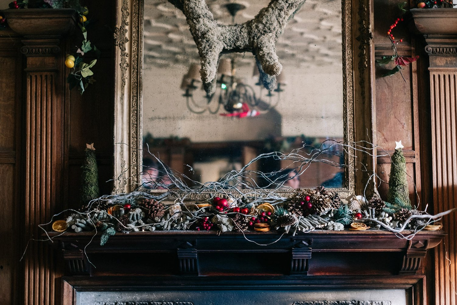 Christmas wedding decor of dried fruit pine cones a d berries Christmas Wolley Grange Wedding Bradford-on-Avon