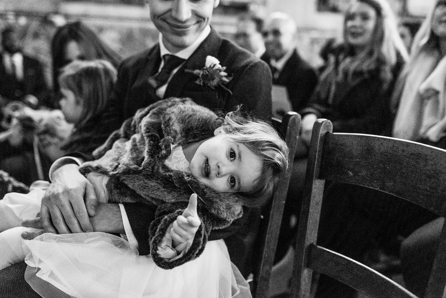 Candid black and white shot of little girl at Asylum chapel