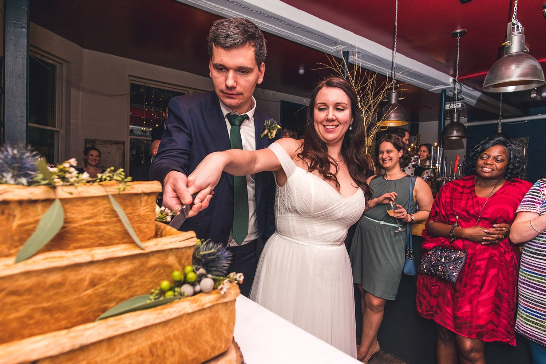 Cutting the cake Winter Wedding The Lordship pub Dulwich