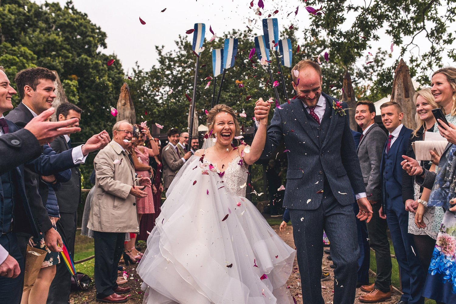 Bride and groom exit with confetti Tournerbury Woods Estate Wedding