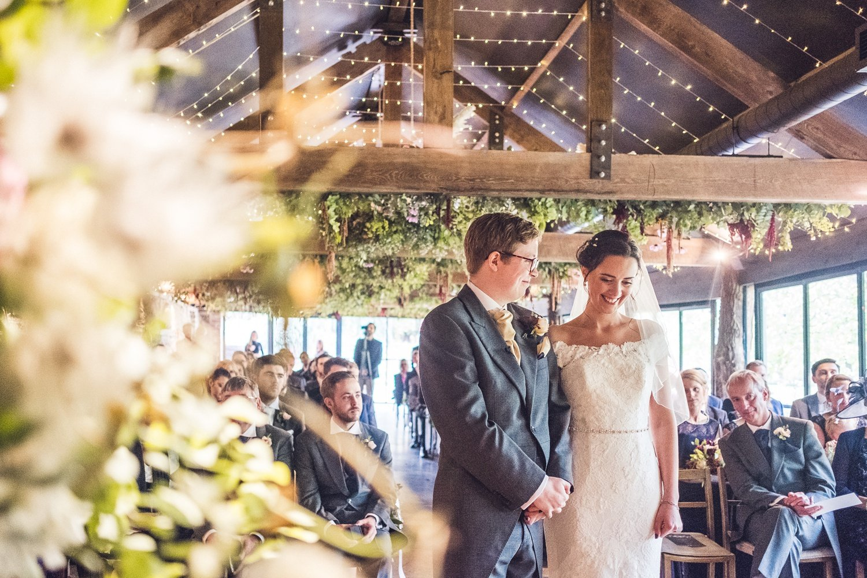 Bride and groom saying vows Bride and groom under umbrella Bride and groom Rainy-Dewsel-Court-Wedding