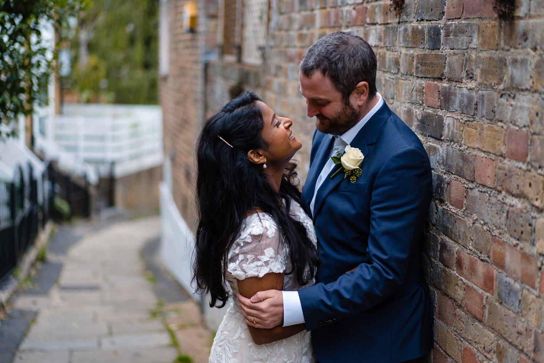 Bride and groom hugging in Hampstead