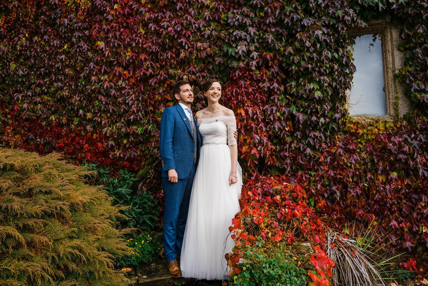 Bride and Groom in front of Autumnal wall Hyde House Wedding Photography